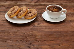 Donuts and coffee. The sweetness of aromatic coffee Royalty Free Stock Photography