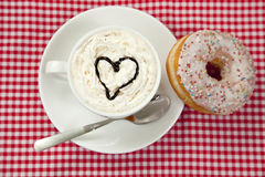 Donuts with coffee on table. Stock Image