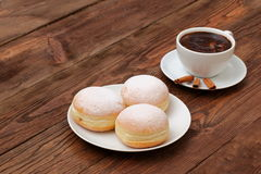Donuts and coffee. Top sweet coffee every morning adds fun for the whole day Stock Photos