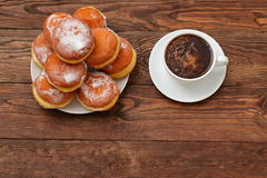 Donuts and coffee. Top sweet coffee every morning adds fun for the whole day Royalty Free Stock Image