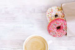 Donuts and coffee Stock Photos