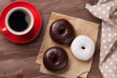 Donuts and coffee Stock Images