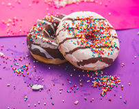 Donuts on color background Royalty Free Stock Photo