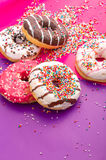 Donuts on color background. Royalty Free Stock Images