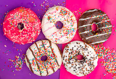 Donuts on color background. Royalty Free Stock Photos