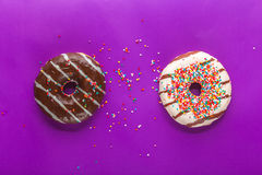 Donuts on color background. Royalty Free Stock Photography