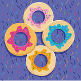 Donuts on the colorful backgound Stock Photos