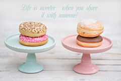Donuts. Colorful delicious donuts with Inspirational Quotes Royalty Free Stock Photo