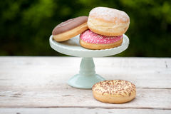 Donuts. Colorful delicious donuts on a wooden white table Royalty Free Stock Images