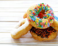 Donuts with colorful glaze Stock Photos