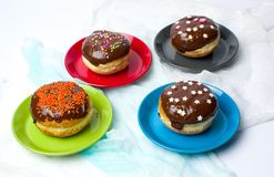 Donuts on colorful plates top view Stock Image