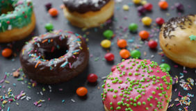 Donuts and colorful sprinkles Stock Photo