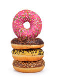 Donuts with colorful sugar icing isolated on white background. Royalty Free Stock Photo