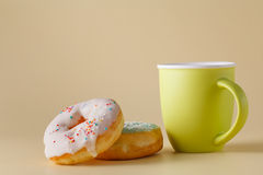 Donuts on cream color background Stock Images
