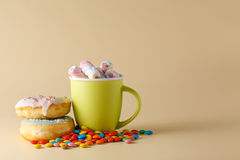 Donuts on cream color background Stock Photos