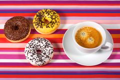 Donuts with cup of coffee Royalty Free Stock Image
