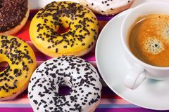 Donuts with cup of coffee Stock Image