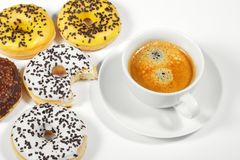 Donuts with cup of coffee Royalty Free Stock Photo