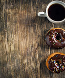 Donuts and cup of coffee Royalty Free Stock Photos