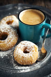 Donuts and cup of coffee. Royalty Free Stock Photography