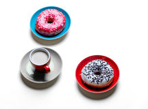 Donuts and cup of coffee Stock Images
