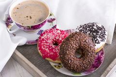 Donuts and cup of coffee Royalty Free Stock Images