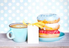 Donuts & cup coffee on wooden table background. Stock Images
