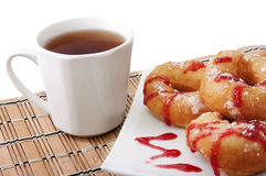 Donuts  and a cup of tea Royalty Free Stock Photos