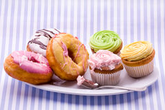 Donuts and cupcakes Royalty Free Stock Image