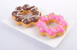 Donuts. delicious and sweet donuts on background Royalty Free Stock Photo
