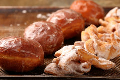 Donuts and faworki. Traditional Polish cookies on Fat Thursday.  Stock Photography