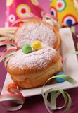 Donuts and festive decoration Stock Photos