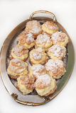 Donuts filled with yellow cream on metal tray Stock Image