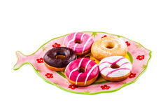 Donuts on a fish shaped plate Royalty Free Stock Photography