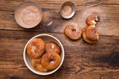 Donuts flavored with cinnamon, nutmeg and powdered. Sugar on a wooden table stock photos