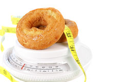 Donuts on Food Scale with Tape Measure Stock Photography