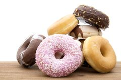 Donuts fresh on background. Donuts and bagels on antique wood royalty free stock image