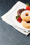 Donuts with fresh strawberries Royalty Free Stock Photos