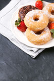 Donuts with fresh strawberries Stock Image