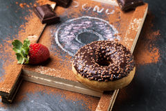 Donuts with fresh strawberries and chocolate Royalty Free Stock Photo