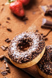 Donuts with fresh strawberries and chocolate Stock Photo