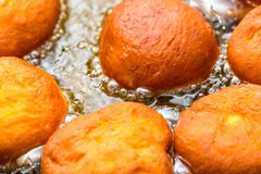 Donuts frying in deep fat Stock Photos