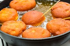Donuts frying in deep fat Royalty Free Stock Photo