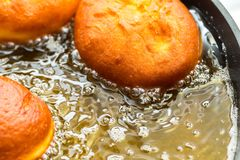 Donuts frying in deep fat Royalty Free Stock Images