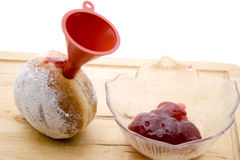Donuts with funnel and jam Royalty Free Stock Image