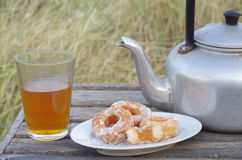Donuts with ginger tea Stock Photos