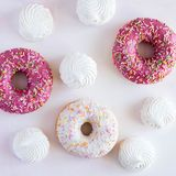 Donuts in glaze. On the white background stock image