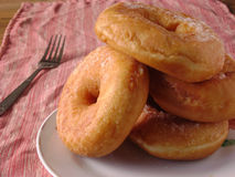 Donuts glazed with a sugar icing. Fried ring donuts glazed with a sugar icing Stock Photography