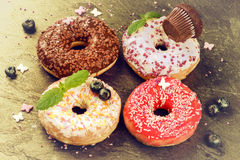 Donuts glazed with various sprinkles. Sweet food background Royalty Free Stock Photography