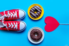 Donuts, gumshoes and toy Royalty Free Stock Image
